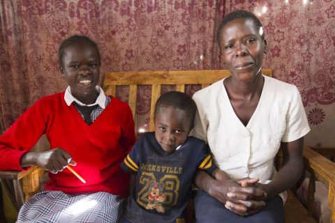 A mother with two children, sitting