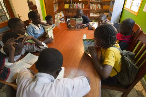 Group of students reading in our library
