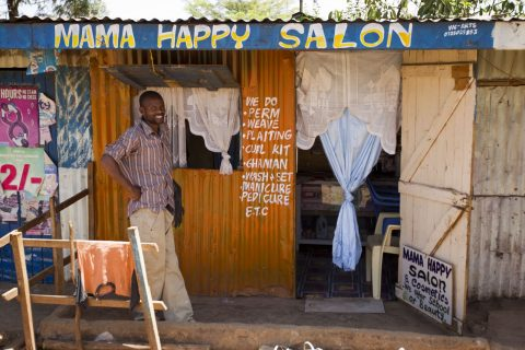 Man standing in front of Mama Happy Salon