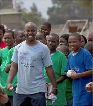 Smiling_Camp_Leader_With_Students