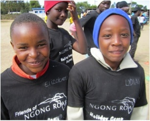 two children at camp, wearing Friends of Ngong Road camp shirts